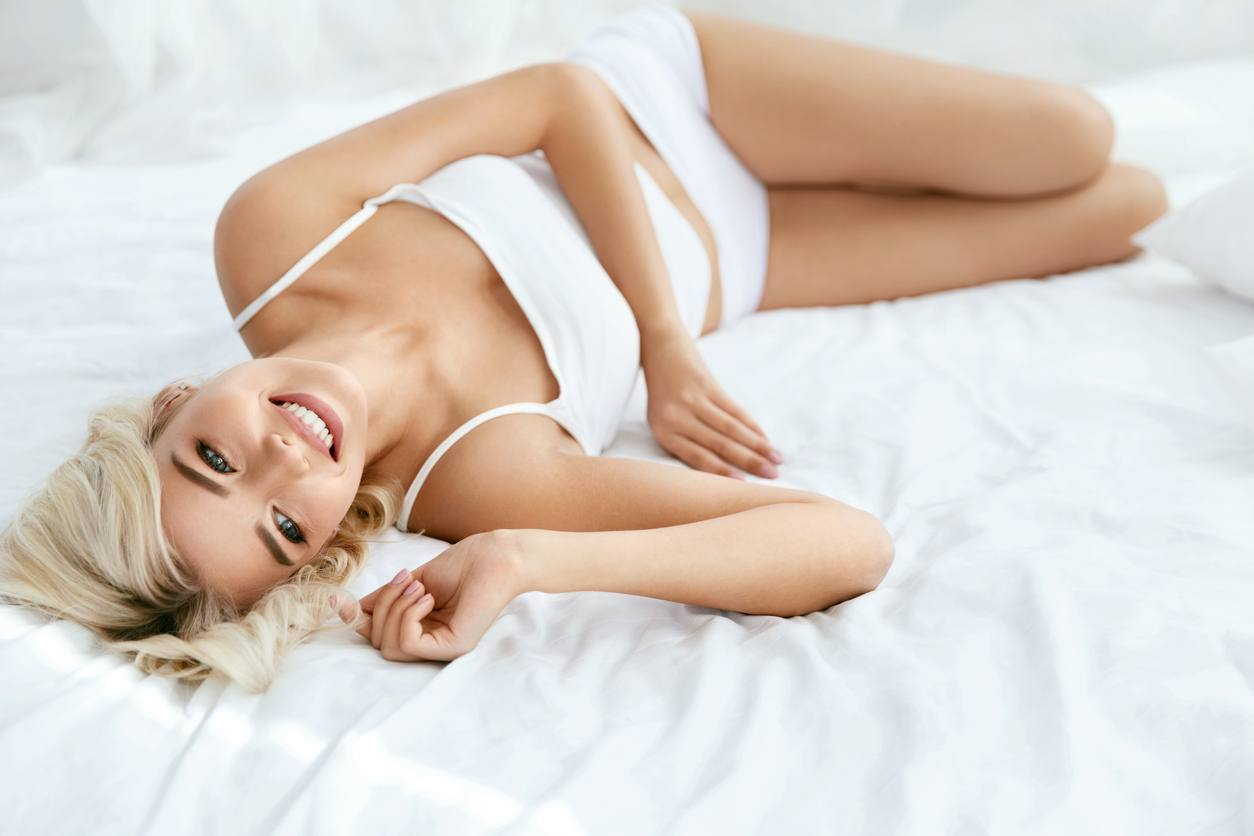 Beautiful Smiling Woman With Blond Hair And Beauty Face